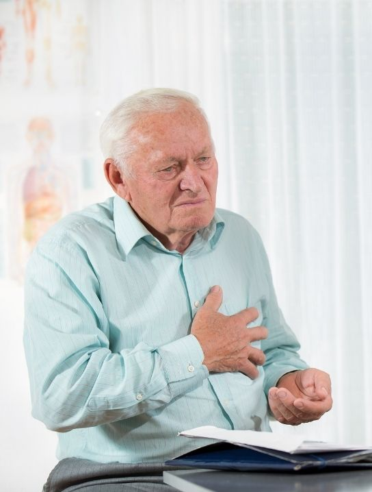 Senior-having-chest-pain-from-heart-disease-image-for-Cardiopulmonary-care-program-provided-by-comfort-home-health-agency
