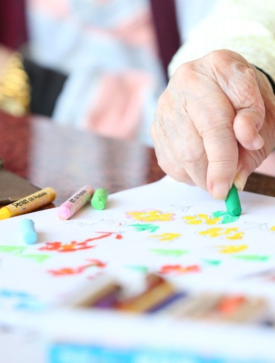 Senior-drawing-as-part-of-the-Occupational-therapy-program-available-at-comfort-Home-health-agency-home-care-agency-in-florida